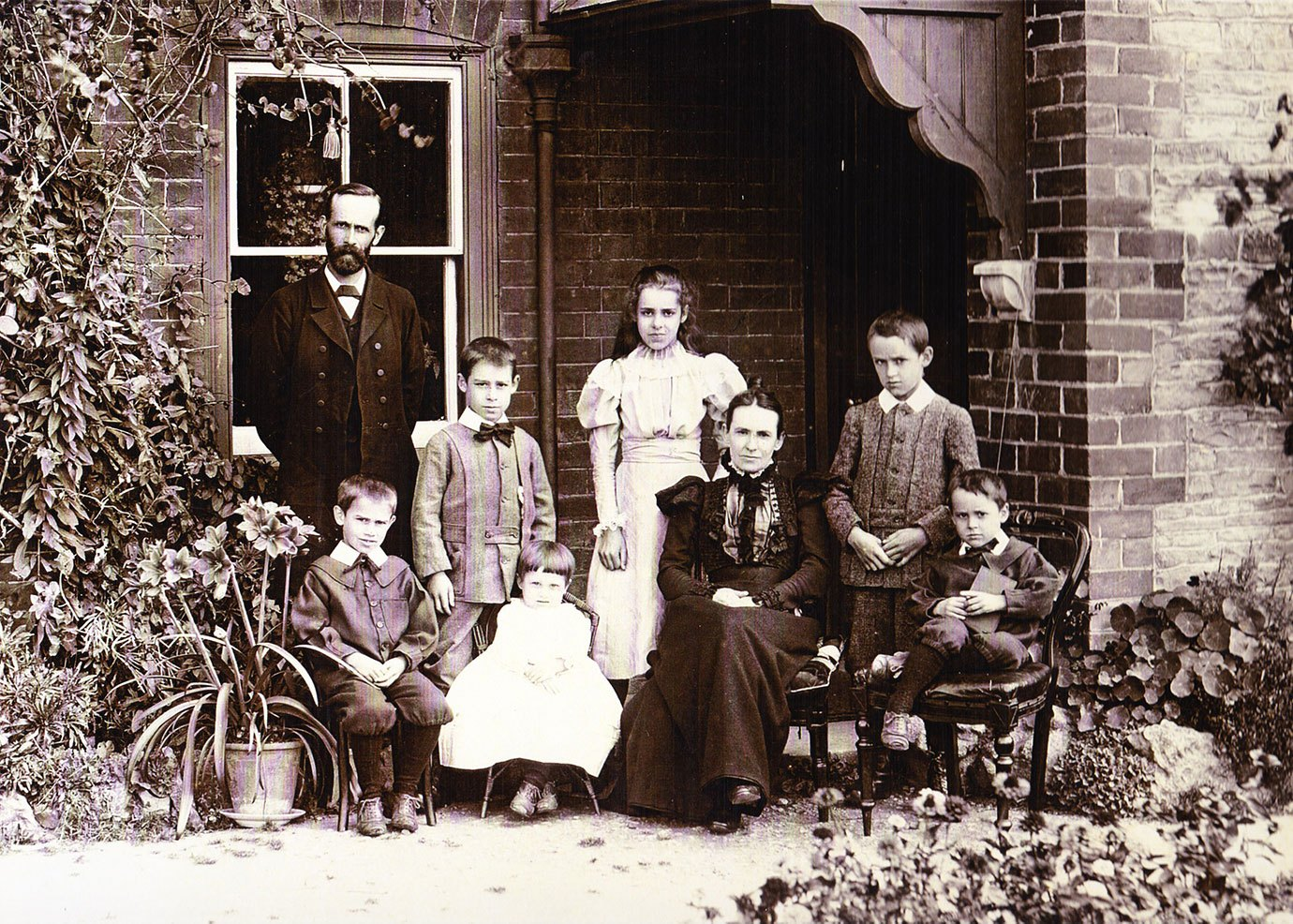 Rev. Ashton and his family outside the old manse, 1895