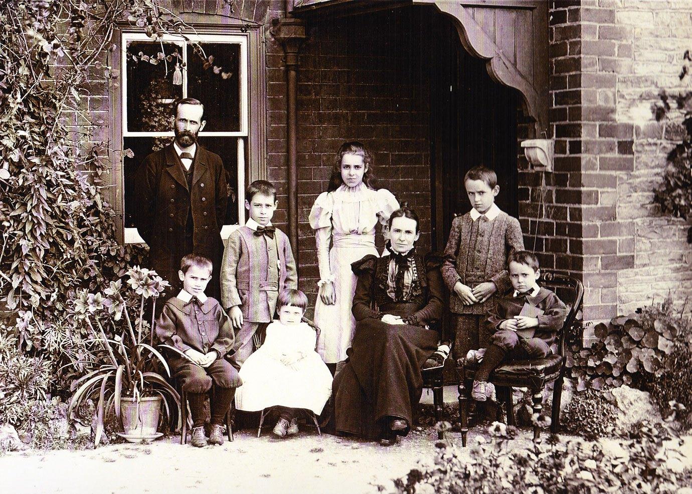 Rev. Ashton and his family outside the old manse, 1895